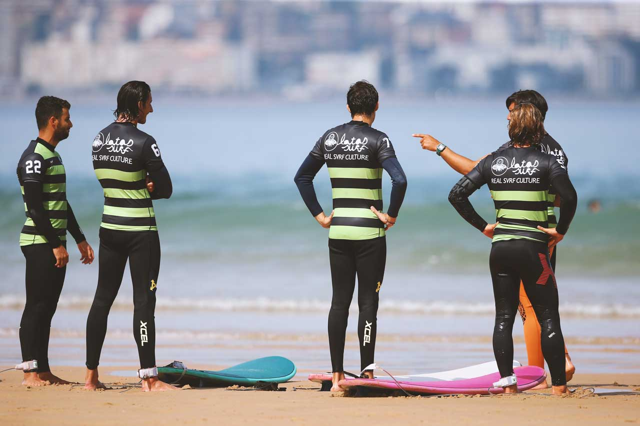 Young men at a surfing lesson with Latas Surf School in Somo Spain