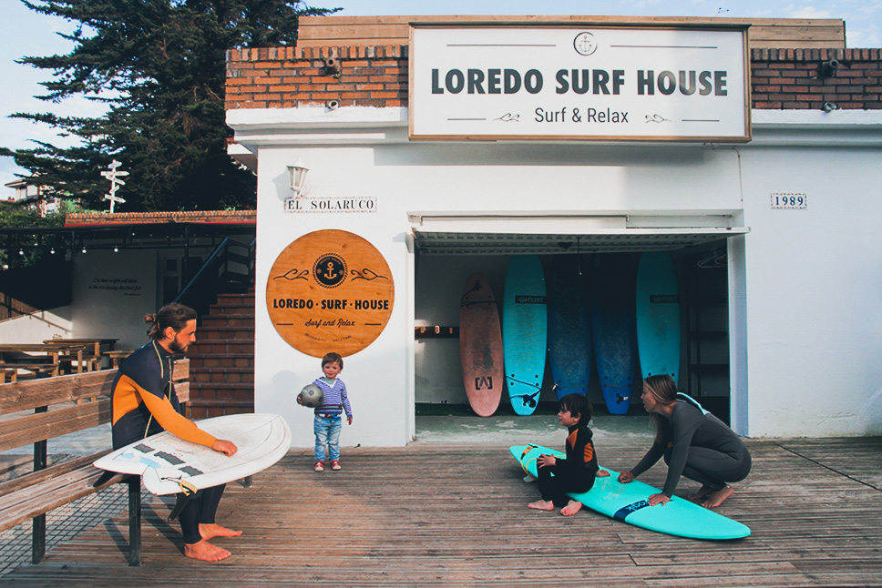 A family prepares for surfing