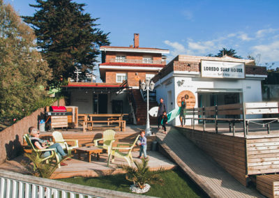 A family goes surfing at a beautiful loredo surf house garden